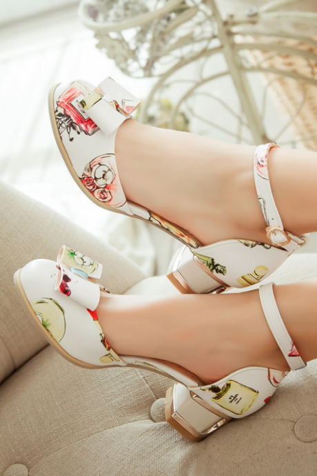Stacked Heel Pumps With Patent Bow Featuring Ankle Straps