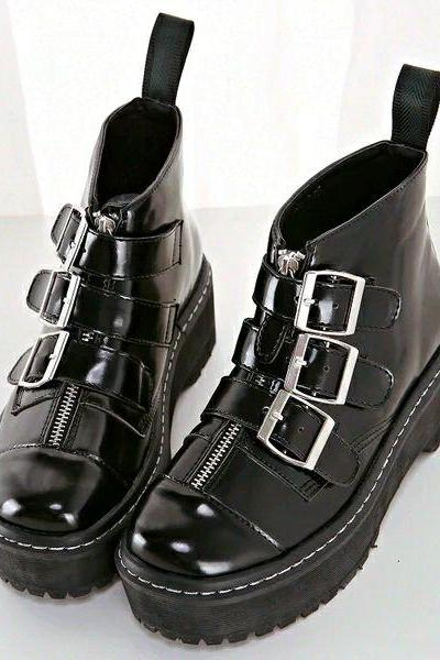 Black Faux Leather Combat Boots Featuring Buckle Straps and Zipper Detailing